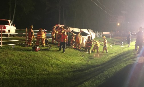Firefighters Work In Rain To Free Couple From Crashed Vehicle